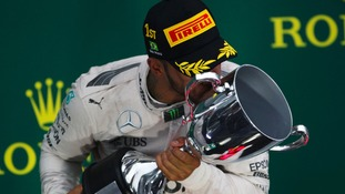 Lewis Hamilton celebrates his win in Brazil yesterday.