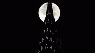 The 'supermoon' can be seen behind the Chrysler Building in New York.