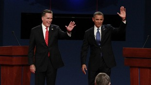 US President Obama and Republican presidential nominee Romney take the stage prior to the first presidential debate in...