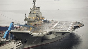 China's first aircraft carrier is seen docked at Dalian Port, in Dalian