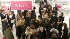 Shoppers in Harvey Nichols department store in Edinburgh, searching for a bargain during the Boxing