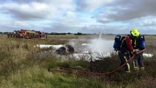 The plane was well alight and the firefighters used foam to put it out.