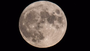 Picture captures jet plane silhouette on Supermoon.