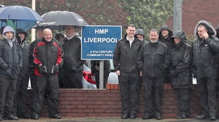 Prison officers 'end walkout' after court rules it unlawful