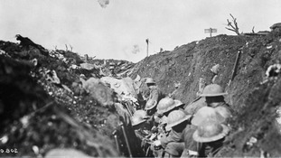 Shrapnel bursts over a trench above Canadian lines during the Battle of the Somme in France, 1916.