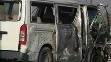 A van is towed away after the blast.