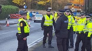 Police at the scene in Rustlings Road.