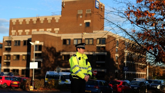 A police officer stands at the entrance to Baird Street Police Station in Glasgow