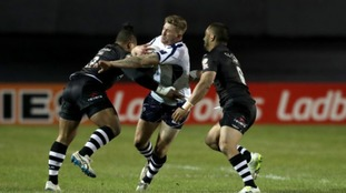 Scotland's Ben Hellewell is tackled by New Zealand's Solomone Kata (left) and Thomas Leuluai