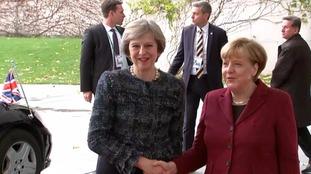Theresa May was greeted by Angela Merkel