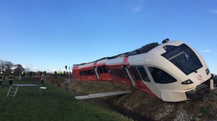 Several people injured after a train hits milk truck and derails in the Netherlands