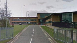 Pupil, 15, in hospital after falling 15ft from balcony at school