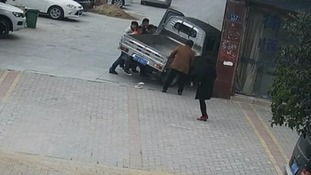People lift truck off girl and free her