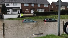Cars submerged in water after flooding in Bristol.