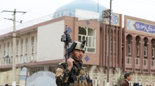 Afghan security forces keep watch after the explosion.