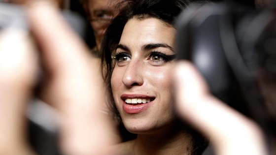 Amy Winehouse surrounded by cameras in 2008.