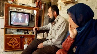 Palestinians watch speech by US President Barack Obama at their house in the southern Gaza Strip in 2009.