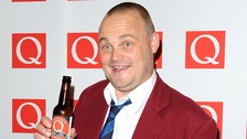 Al Murray posing at the Q Awards