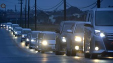 A traffic jam is seen as people evacuate after tsunami advisories were issued following the earthquake, in Iwaki, Fukushima prefecture.