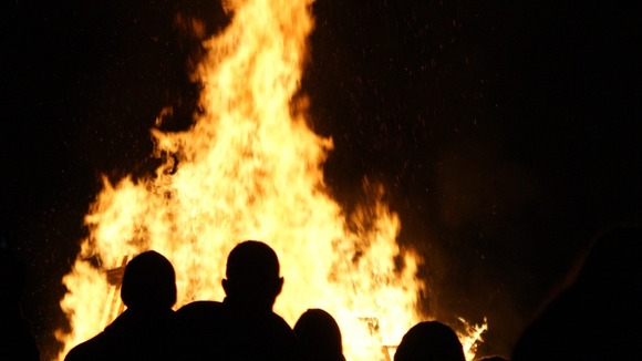 Families gather around the bonfire at Walker Park, Newcastle