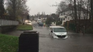 A white van is caught in rising waters