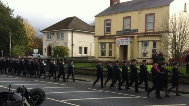 Officers from the Northern Ireland Prison Service provide a guard of honour