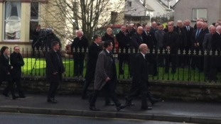 Justice Minister, David Ford, arrives for funeral service