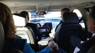 Romney in the back of a car on his way to a polling station in Massachusetts