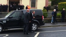 First Minister Peter Robinson arriving for the funeral