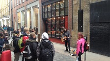 James Bowen performs in Covent Garden with Bob the cat by his side.