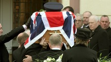 Prison officers carry the coffin to Molesworth Presbyterian Church of murdered colleague David Black