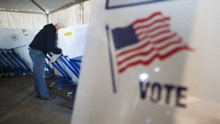 A man votes in a polling site built to service residents of the Queens borough neighborhoods of Breezy Point