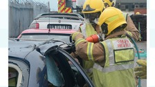 Firefighters demonstrating cutting tools used to rescue motorists at crash sites
