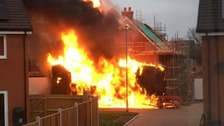 Two vans were on fire where one has exploded and had spread to a nearby property.
