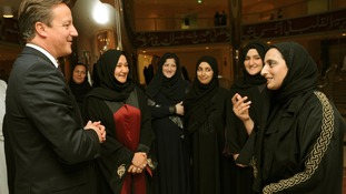 Prime Minister David Cameron meets female students at Dar Al-Hekma University in Jeddah
