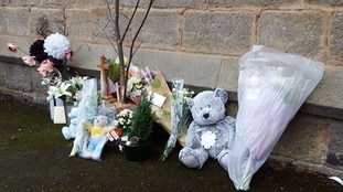 Well-wishers have left tributes to the baby at the vicarage