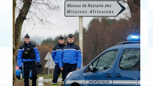 French gendarmes stand guard near the retirement home