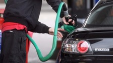 Putting petrol in a car