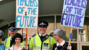 Students join their teachers demonstrating outside the Department of Education.