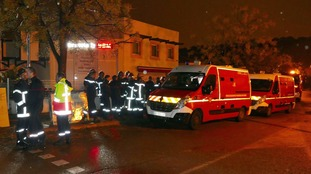 Firefighters and ambulances are seen outside the retirement home on Thursday.