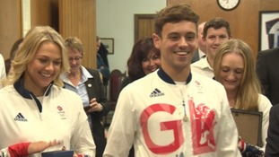 Tom Daley flanked by fellow divers Tonia Couch (L) and Sarah Barrow