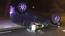 Car flipped on its roof in north west London crash.
