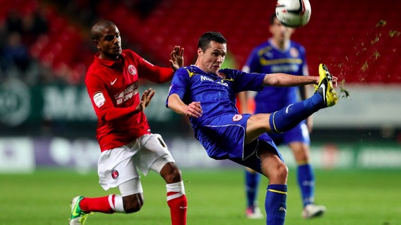 Cardiff City's Don Cowie (right) clears the ball under pressure from Charlton Athletic's Bradley Pritchard