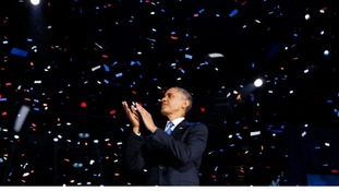 U.S. President Barack Obama applauds after his election night victory speech in Chicago