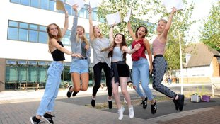 Young girls celebrate their GCSE results.