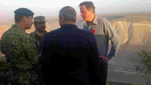 David Cameron is briefed by Jordanian forces at border with Syria