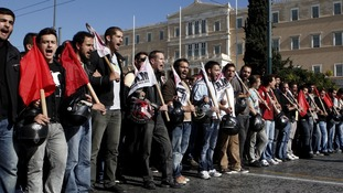 Protesters shout slogans during an anti-austerity rally in front of the parliament in Athens on Tuesday.