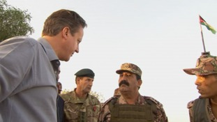 Prime Minister David Cameron speaks with members of the Jordanian Armed Forces