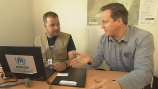 David Cameron meets a UN Refugee Agency worker in Jordan