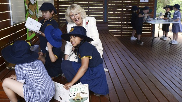 Camilla, Duchess of Cornwall, speaks to children looking after tadpoles at an Adelaide school
